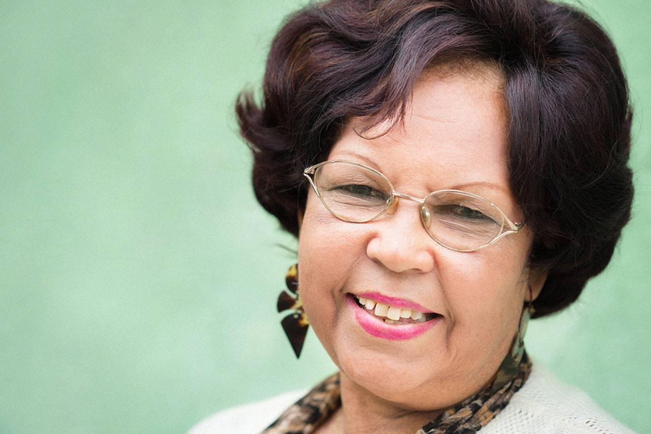 hispanic woman with glasses smiling