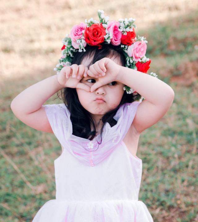 girl covering her face floweers