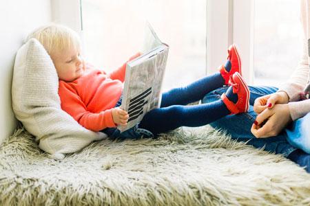 toddier reading book